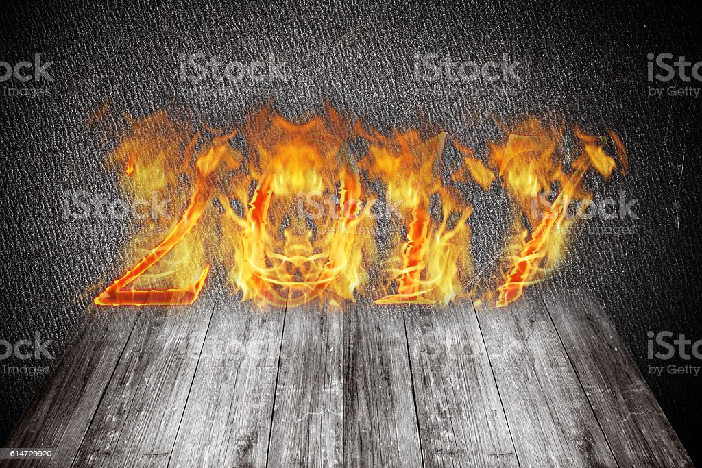 Happy new year 2017 - figures in flame. Collage stock photo