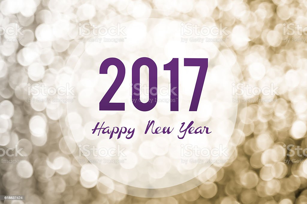 Happy new year 2017 on golden bokeh light background stock photo