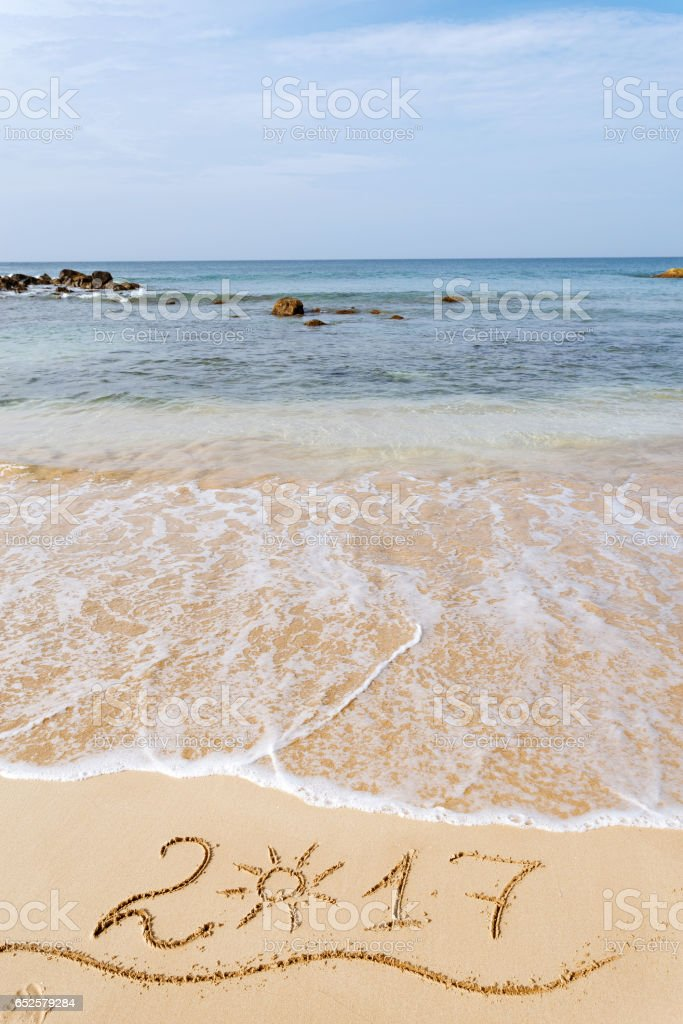 Happy New Year 2017 on the beach stock photo
