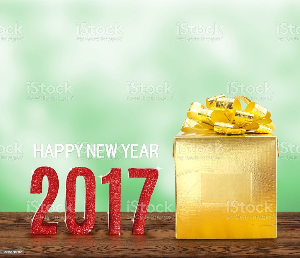 Happy new year 2017 wood number and golden on wood stock photo