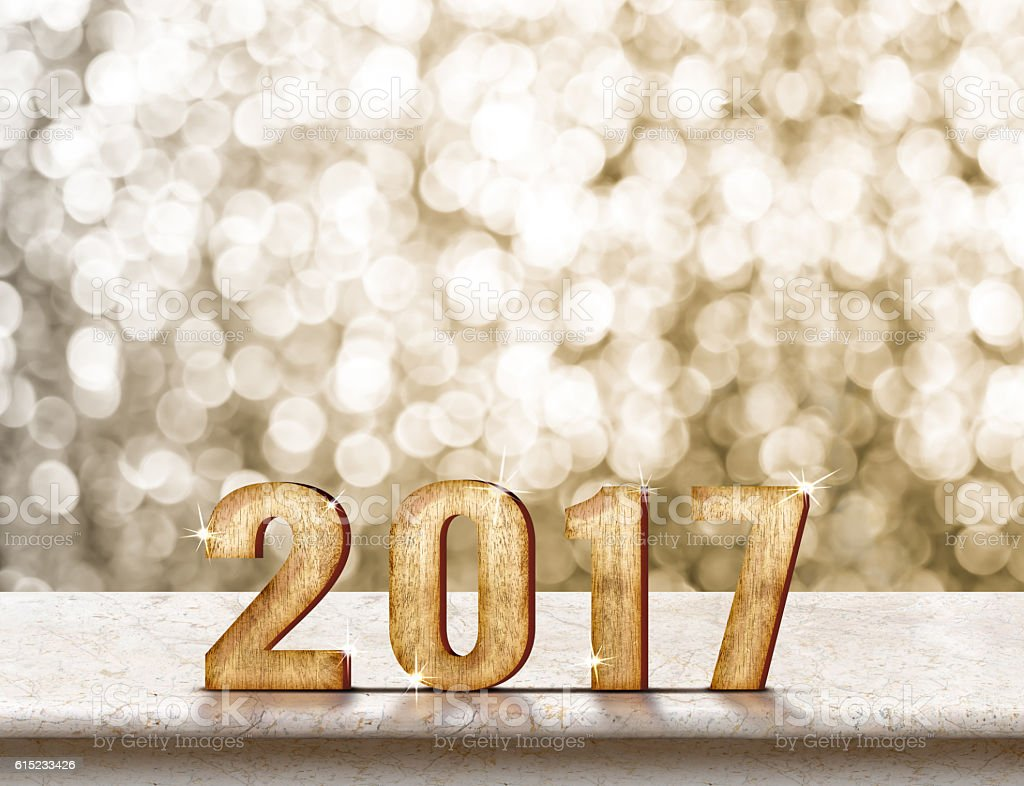 Happy New Year 2017 wood texture on marble table stock photo