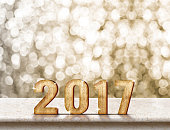 Happy New Year 2017 wood texture on marble table
