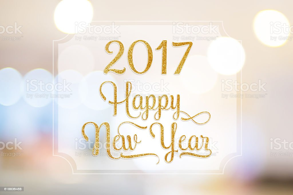 Happy New year 2017 word on white frame at blurred stock photo