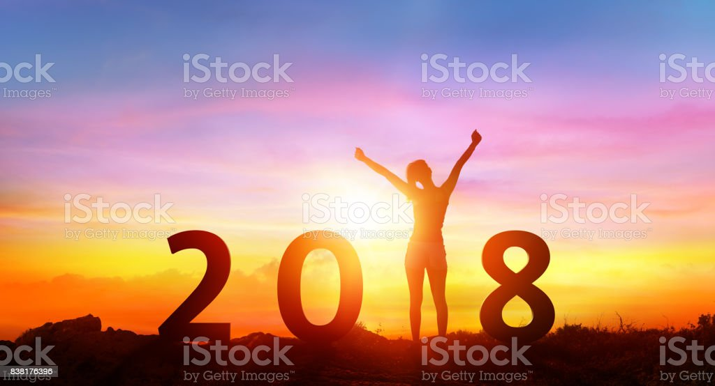 Happy new year 2018 - Happy Girl With Numbers At Sunrise stock photo