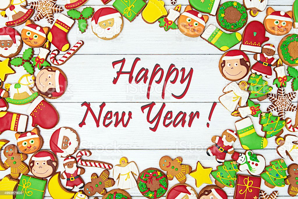 Happy New Year card. With variety of gingerbread cookies stock photo