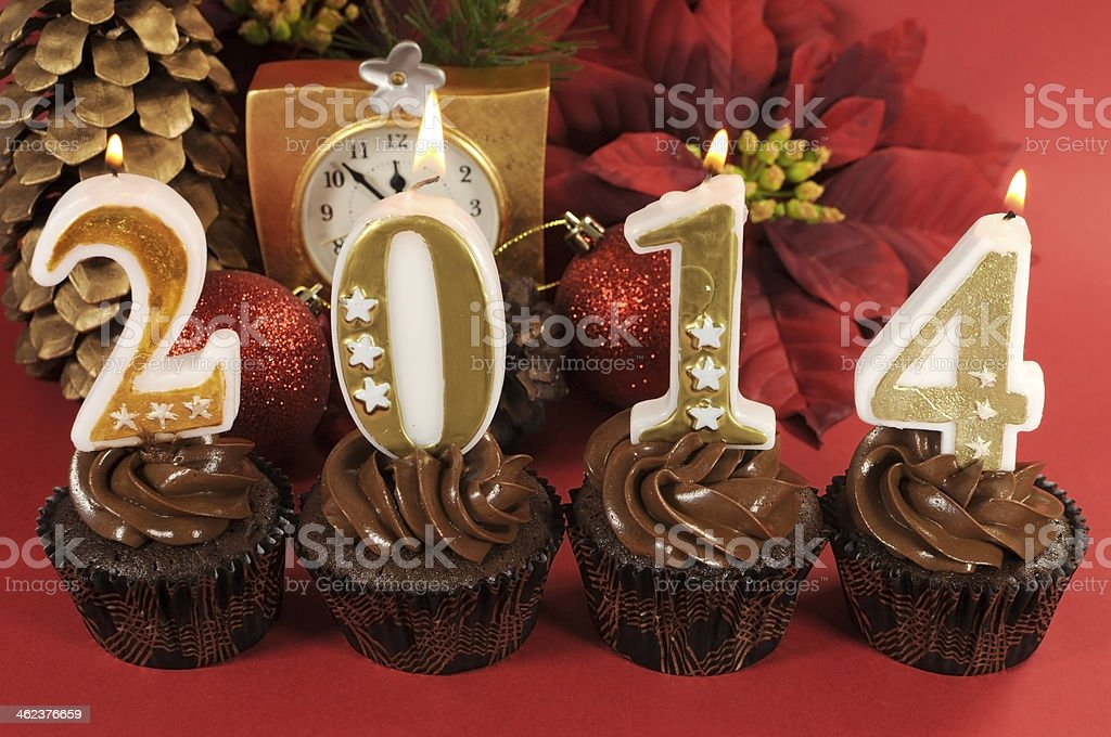 Happy New Year chocolate cupcakes with 2014 number candles stock photo