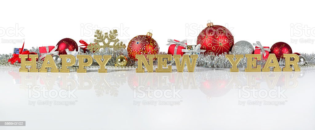Happy New Year golden text and Christmas decorations stock photo