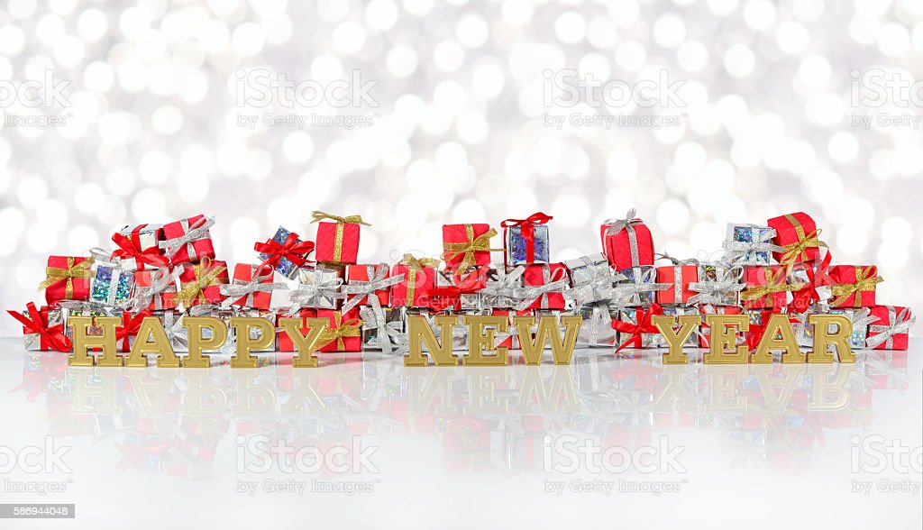 Happy New Year golden text and silver and red gifts stock photo