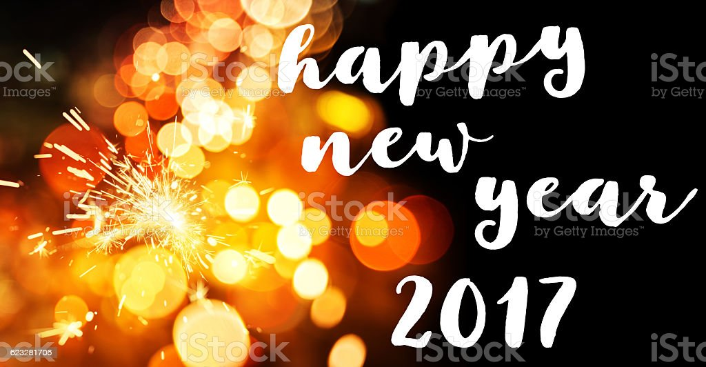 Happy New Year Greeting Over Sparkler and lights stock photo