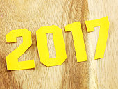 happy new year lettering with the gift on wooden background