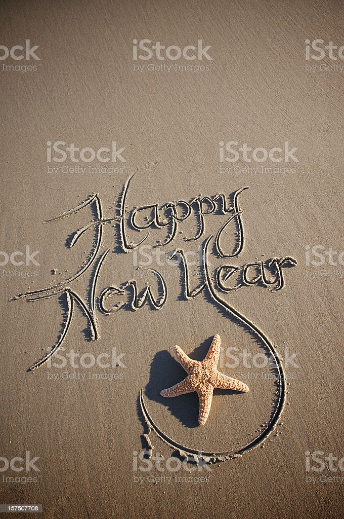 Happy New Year Message with Starfish on Sand royalty-free stock photo