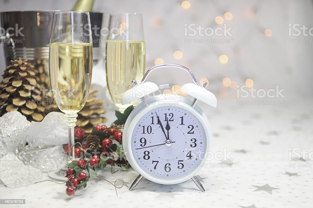 Happy New Year table setting with white retro clock stock photo