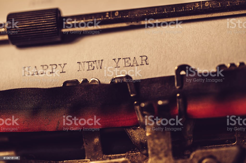 'Happy new year' typed using an old typewriter stock photo