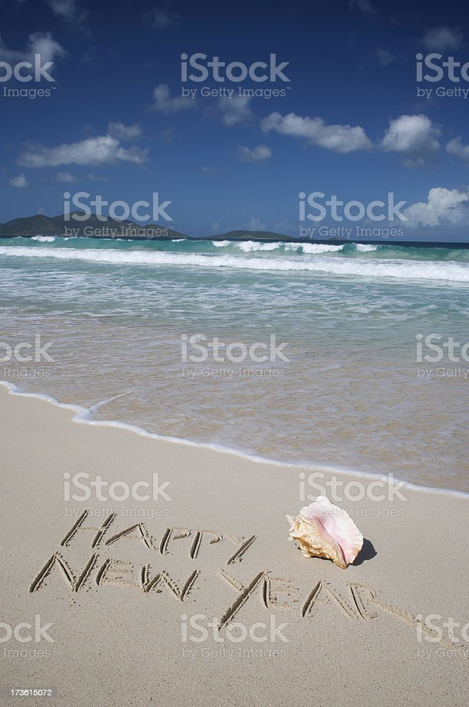 Happy New Year w Conch Shell on Tropical Sand Beach royalty-free stock photo