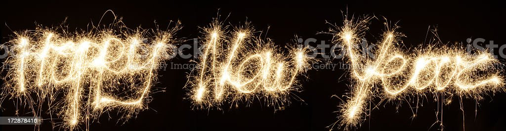 Happy new year written in fireworks on a black background stock photo