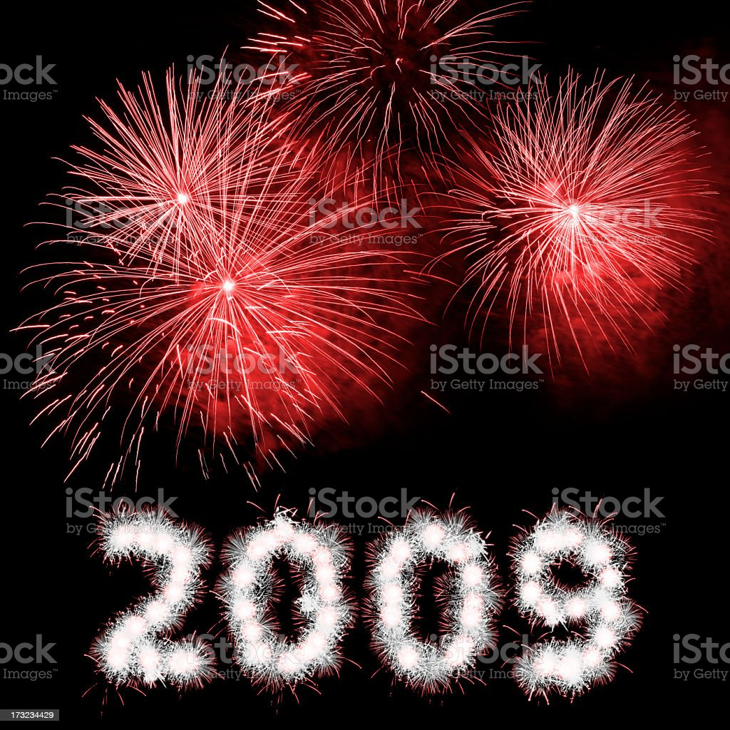 Happy New Year written numbers, red fireworks against dark sky stock photo