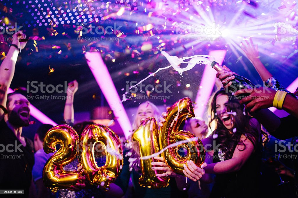 Happy New Years Eve Party in Nightclub with friends stock photo