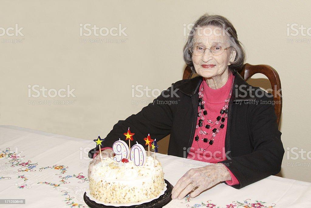 Happy Ninety-Year-Old Woman Celebrating Her Birthday stock photo
