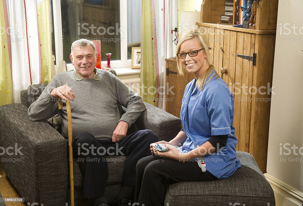 Happy nurse and elderly man royalty-free stock photo
