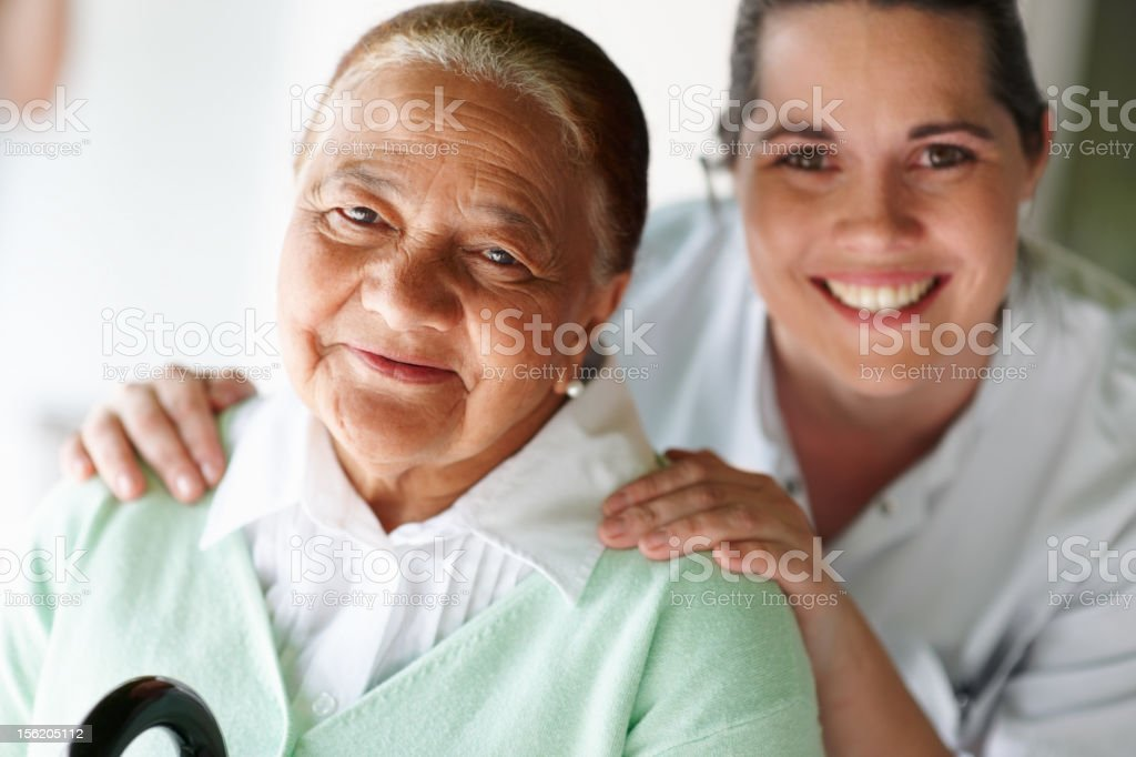 Happy nurse and patient smiling royalty-free stock photo