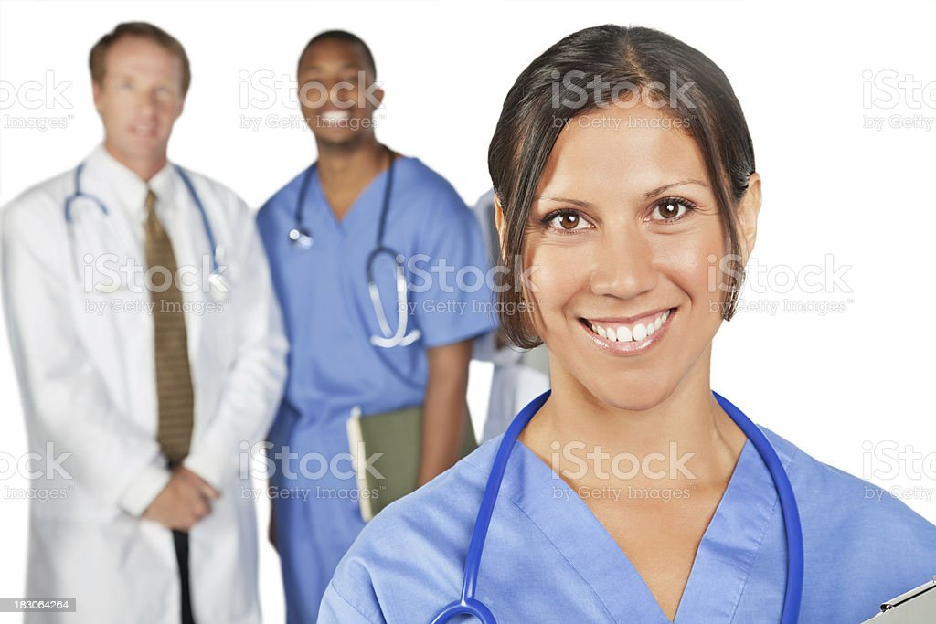 Happy Nurse in Front of Medical Team, Isolated on White royalty-free stock photo