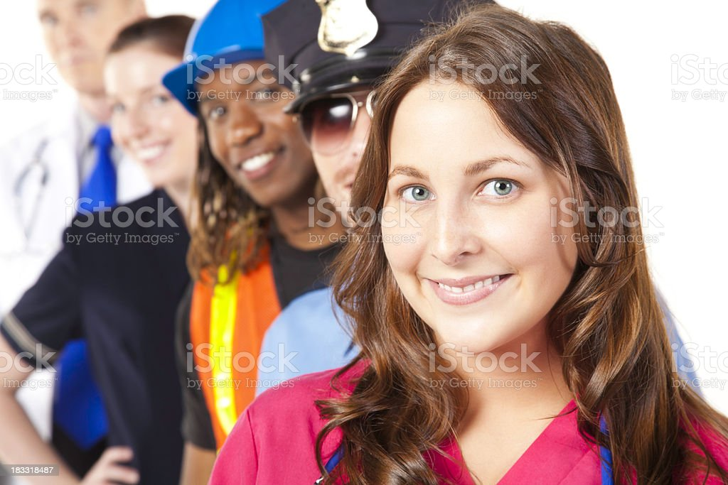 Happy Nurse In Front of Various Workers royalty-free stock photo