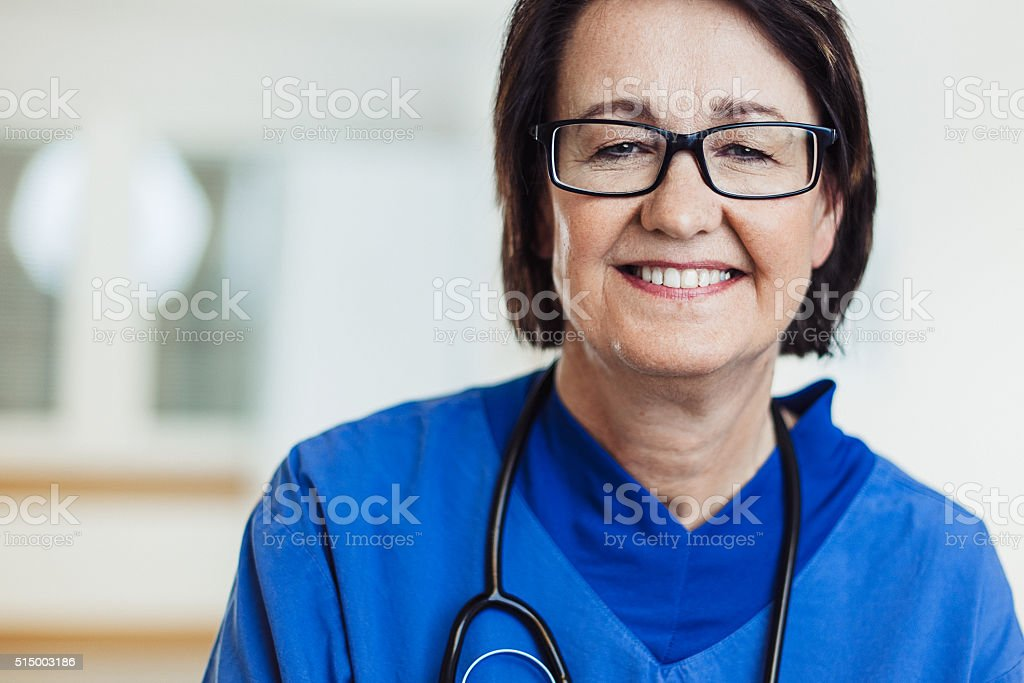 Happy nurse in hospital stock photo