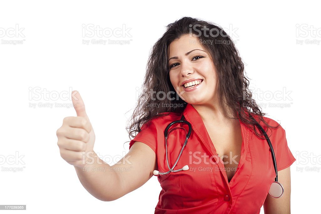Happy nurse or woman doctor with thumb up stock photo