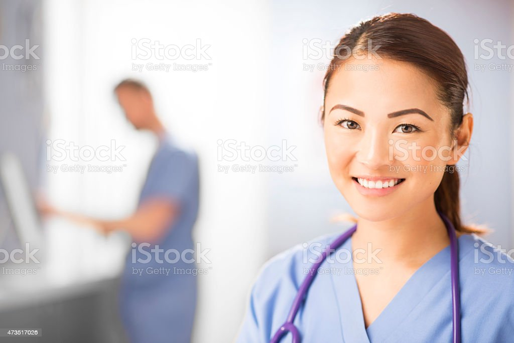 happy nurse portrait in hospital clinic stock photo