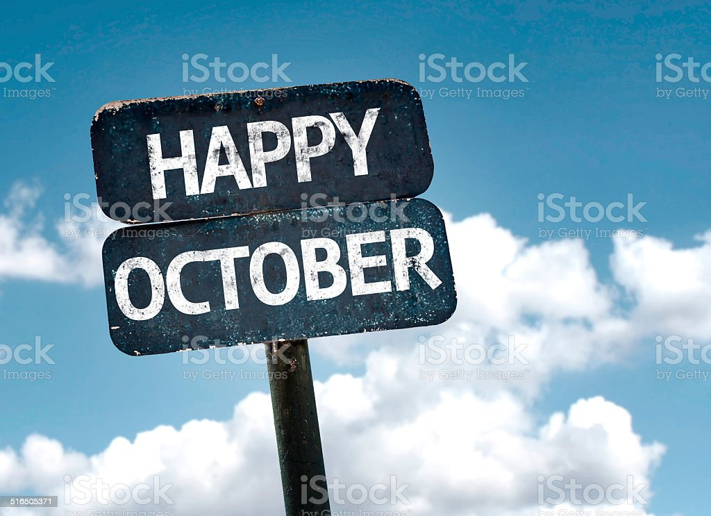 Happy October sign with clouds and sky background stock photo