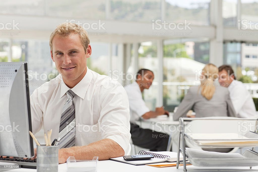 Happy Office Worker at his Desk. royalty-free stock photo