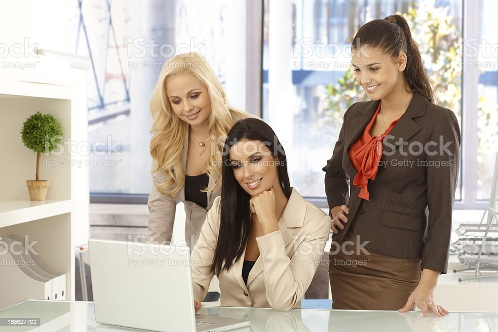 Happy office workers working on computer royalty-free stock photo