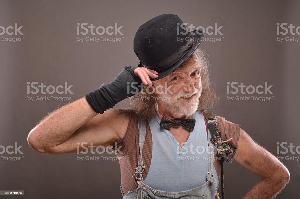 Happy old beggar stock photo