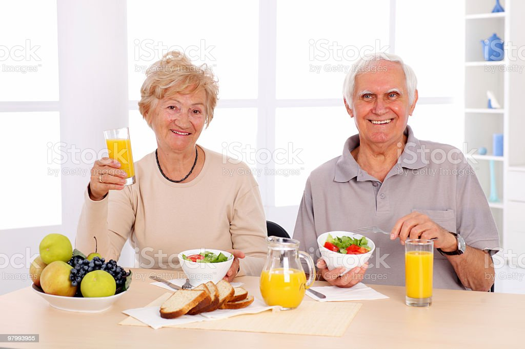 Happy old couple eating healthy breakfast. royalty-free stock photo
