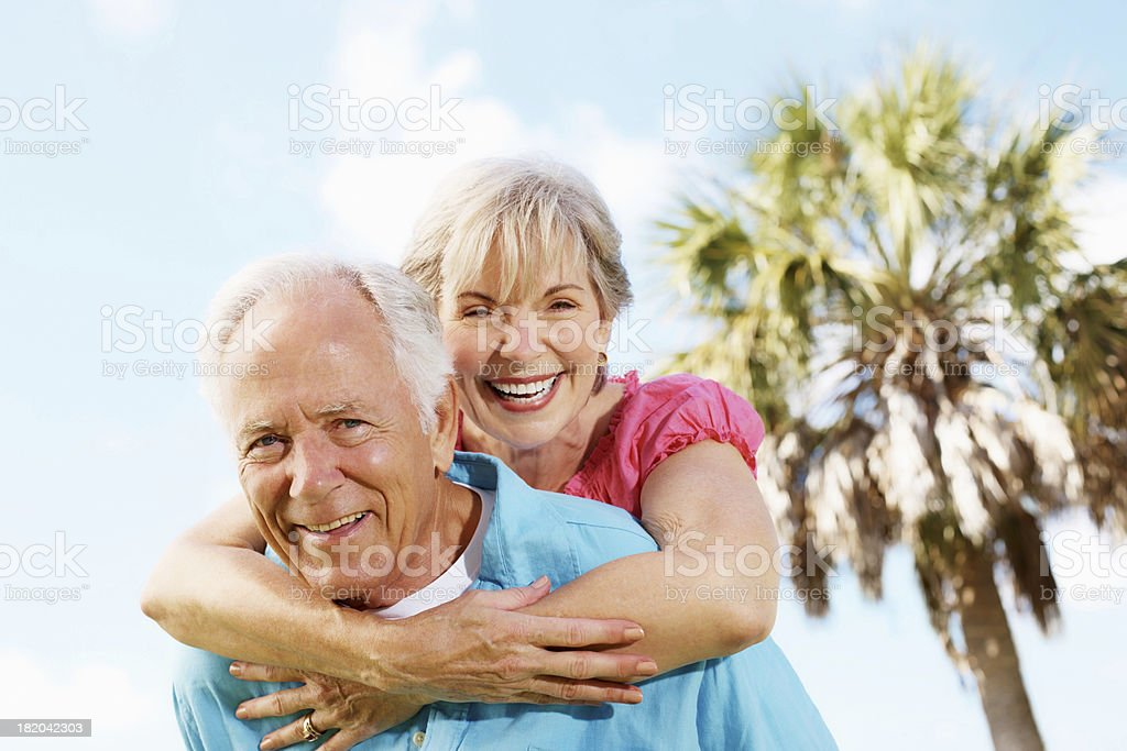 Happy, old couple in playful mood on a sunny day royalty-free stock photo
