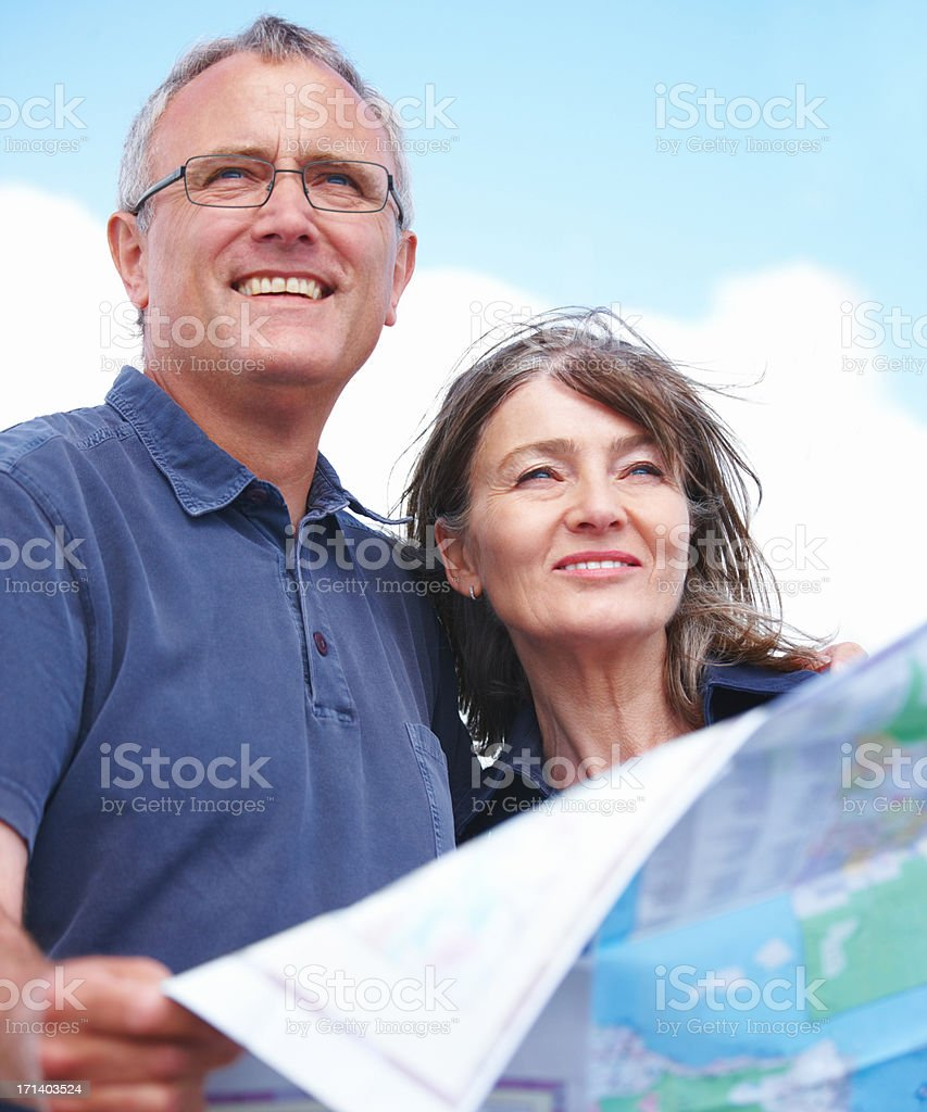 Happy old couple looking ahead with map in hand royalty-free stock photo