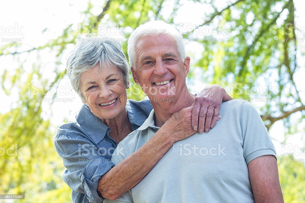 Happy old couple smiling stock photo