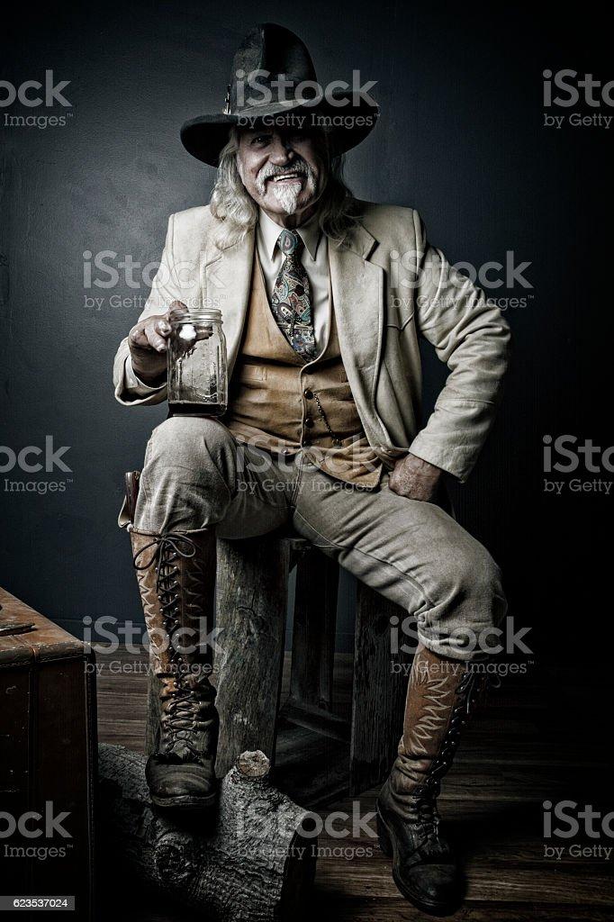 Happy Old Cowboy Pose stock photo