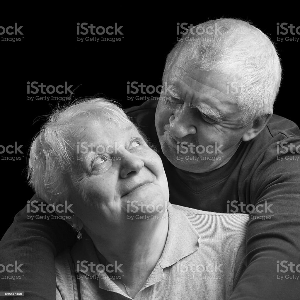 happy older couple on a black background royalty-free stock photo