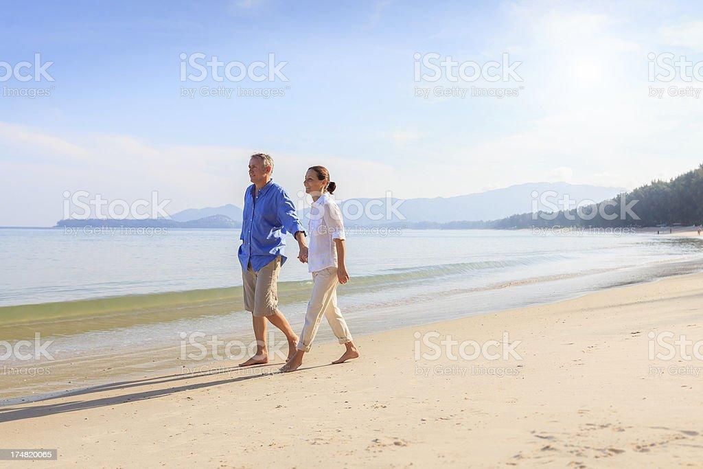 Happy older couple on beach royalty-free stock photo