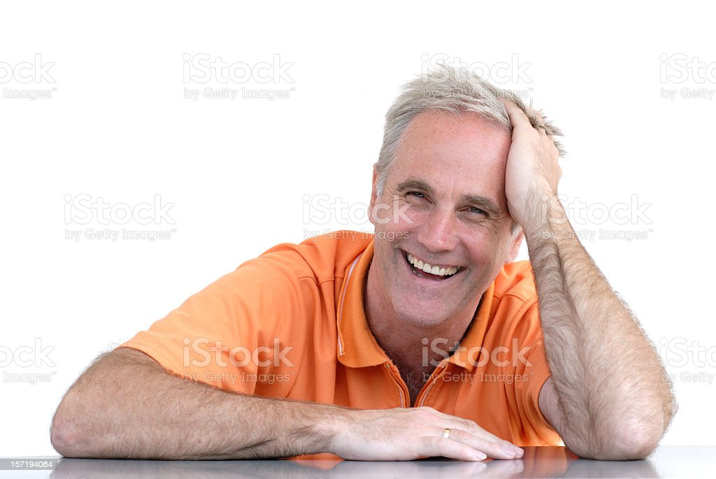 Happy older man leaning on his hand on the table royalty-free stock photo