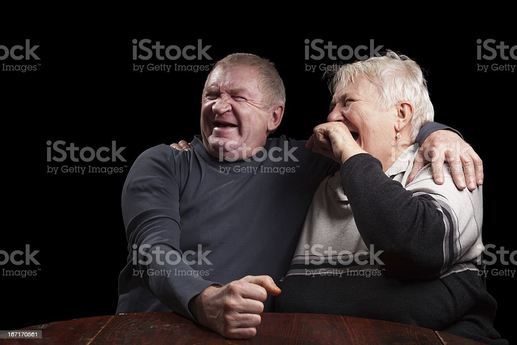 happy older pair on a black background royalty-free stock photo