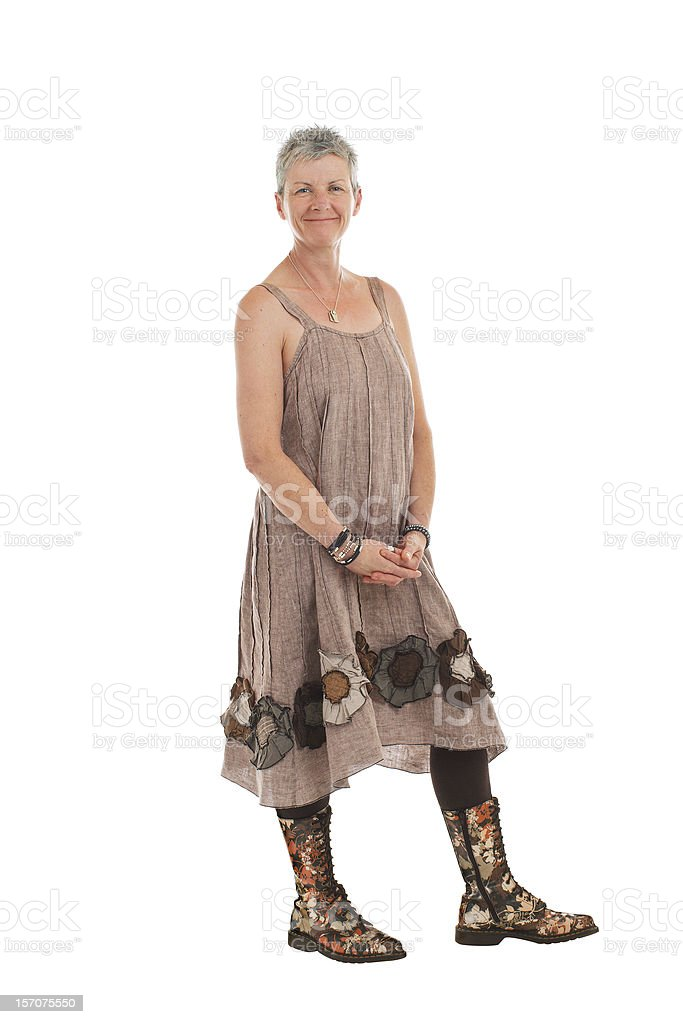 Happy older woman in flowered boots and dress stock photo