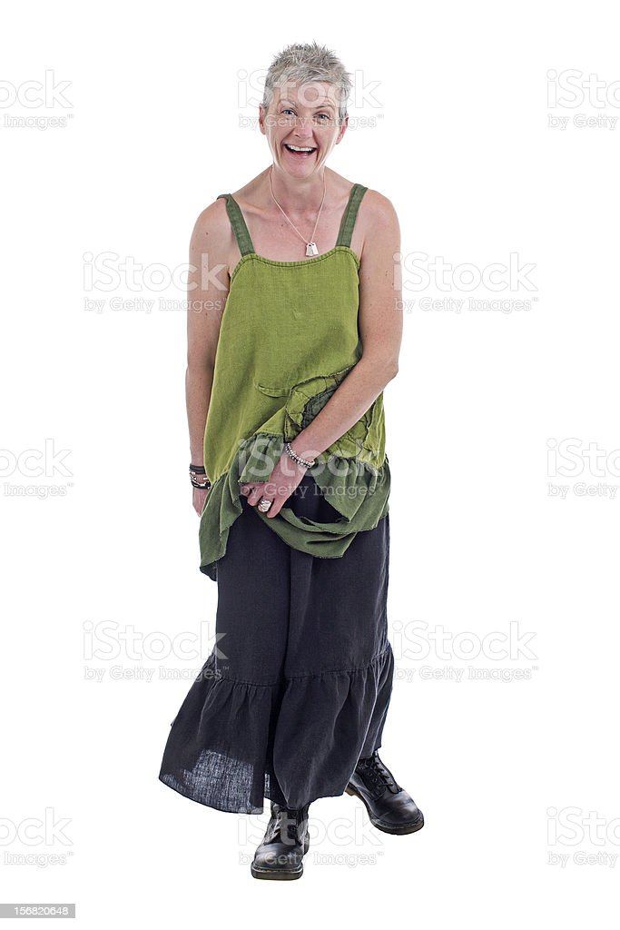 Happy older woman stands in loose flowing long dress royalty-free stock photo