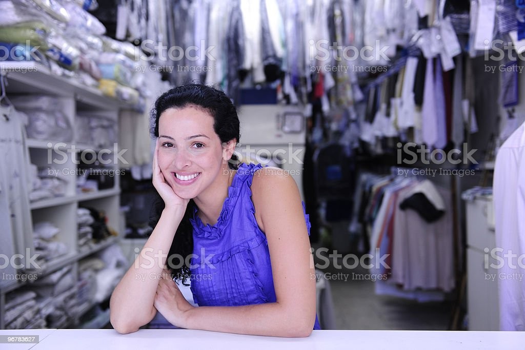happy owner of a dry cleaner store stock photo