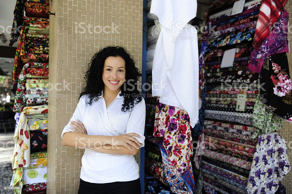 happy owner of a fabric store stock photo