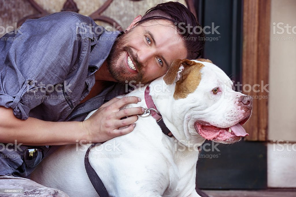 Happy Owner of an American Bull Dog stock photo
