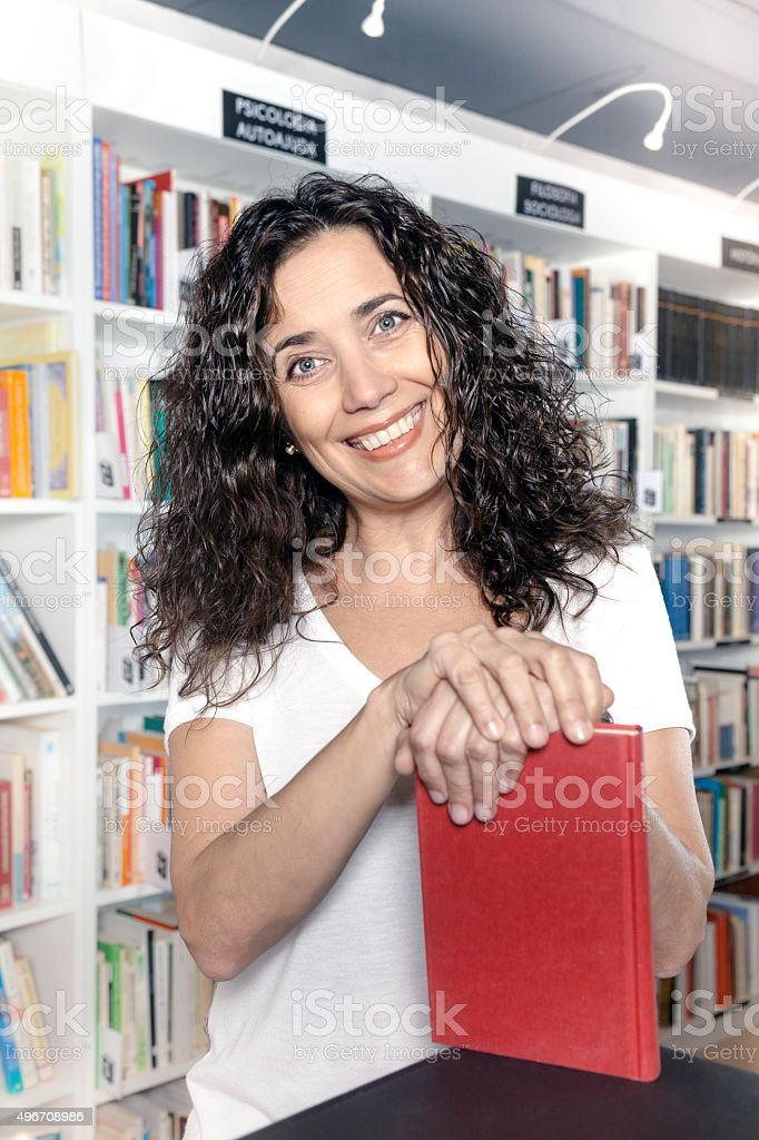 Happy owner woman in the bookstore stock photo