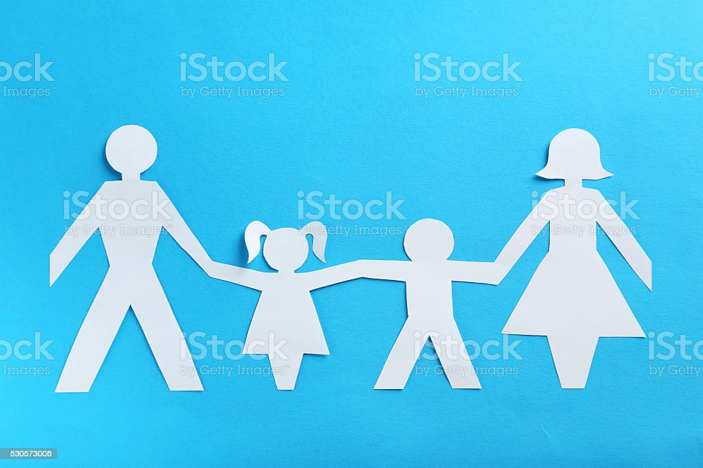 Happy paper family on blue background stock photo