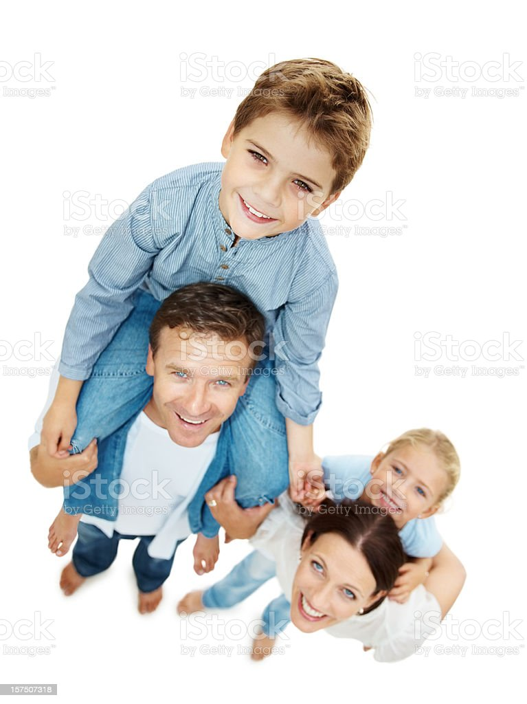 Happy parents carrying their children on shoulders royalty-free stock photo